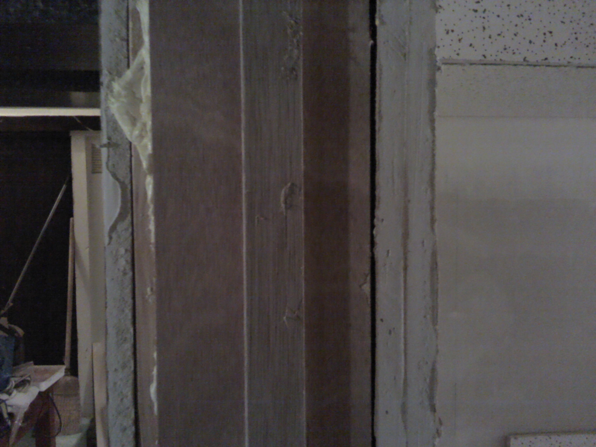 Door Frame in Profile: One  layer of drywall outside, two layers inside, wood and insulation in between