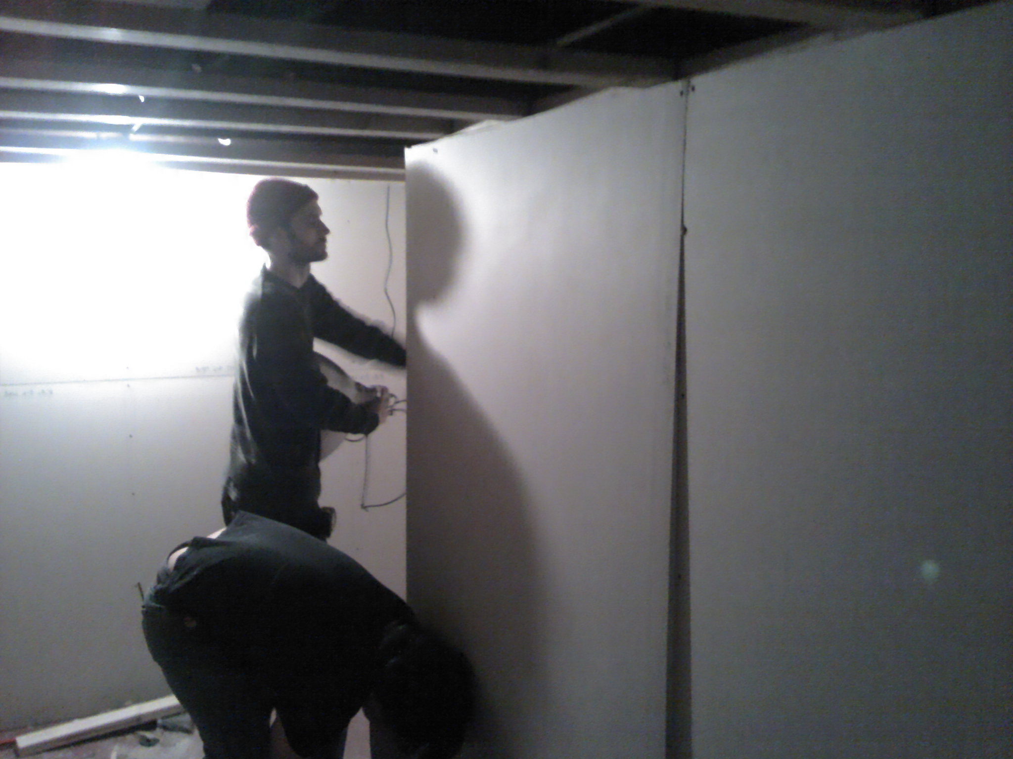 Ben and Mike Wong setting drywall